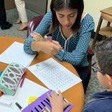 Chapman student tutoring 3rd grade math student