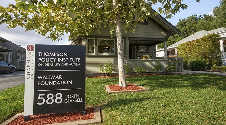 Thompson Policy Institute sign in front of the TPI house on the Chapman University campus