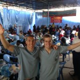 Schmid College alumnus Sean Vreeburg, right, along with fellow dental student organized a large-scale humanitarian dental trip to Kenya.