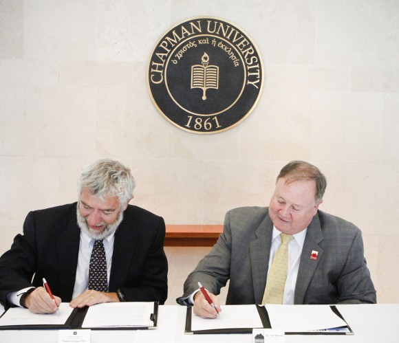 Chancellor Daniele Struppa and president of Saddleback College Dr. Tod Burnett sign the sciences transfer admission guarantee between the two institutions.
