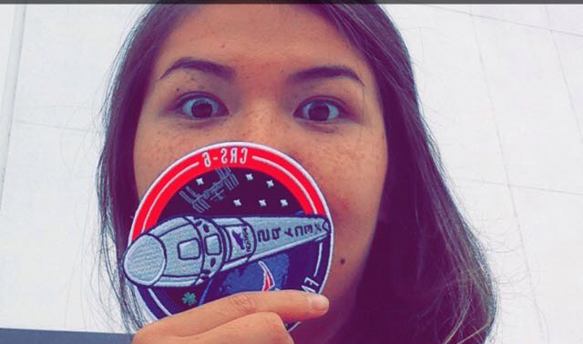 Taylor Krause with a NASA Patch