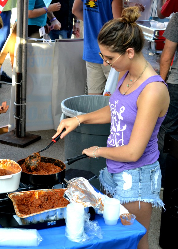 Woman serving chili