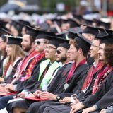 Graduates of Schmid College sit in their seats during the college's 2015 Commencement ceremony.