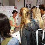 Melissa Rowland-Goldsmith explains her research to a group of enthralled students.
