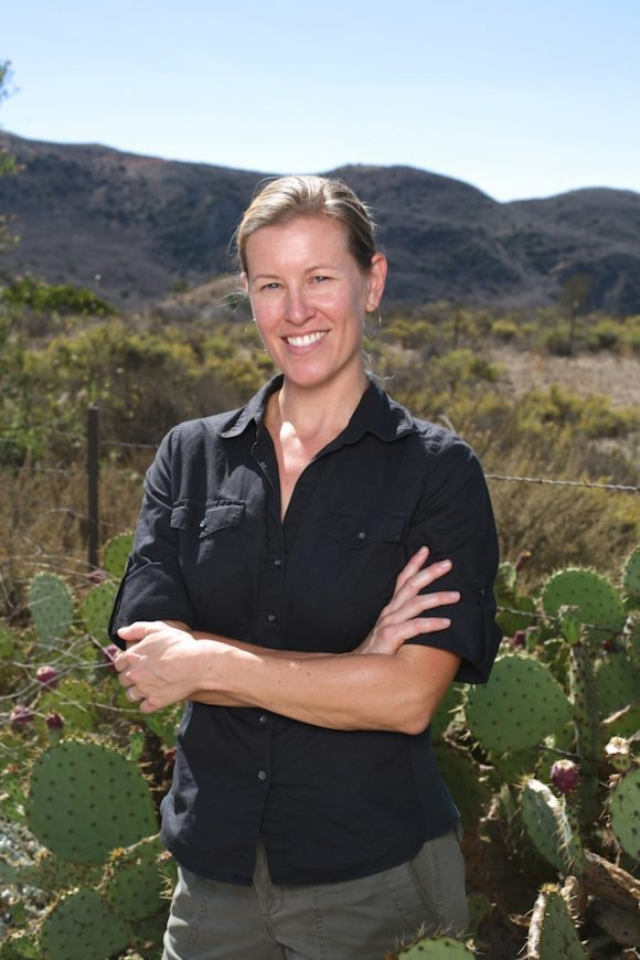 Professor Jennifer Funk, pictured here at the Irvine Ranch Conservancy, researches how native and non-native plants compete for resources.