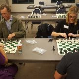 Chess tournament attendees face off in the first round of the tournament.