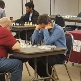 Profs. Fred Caporaso (left) and Roman Buniy (right) play each other in chess.