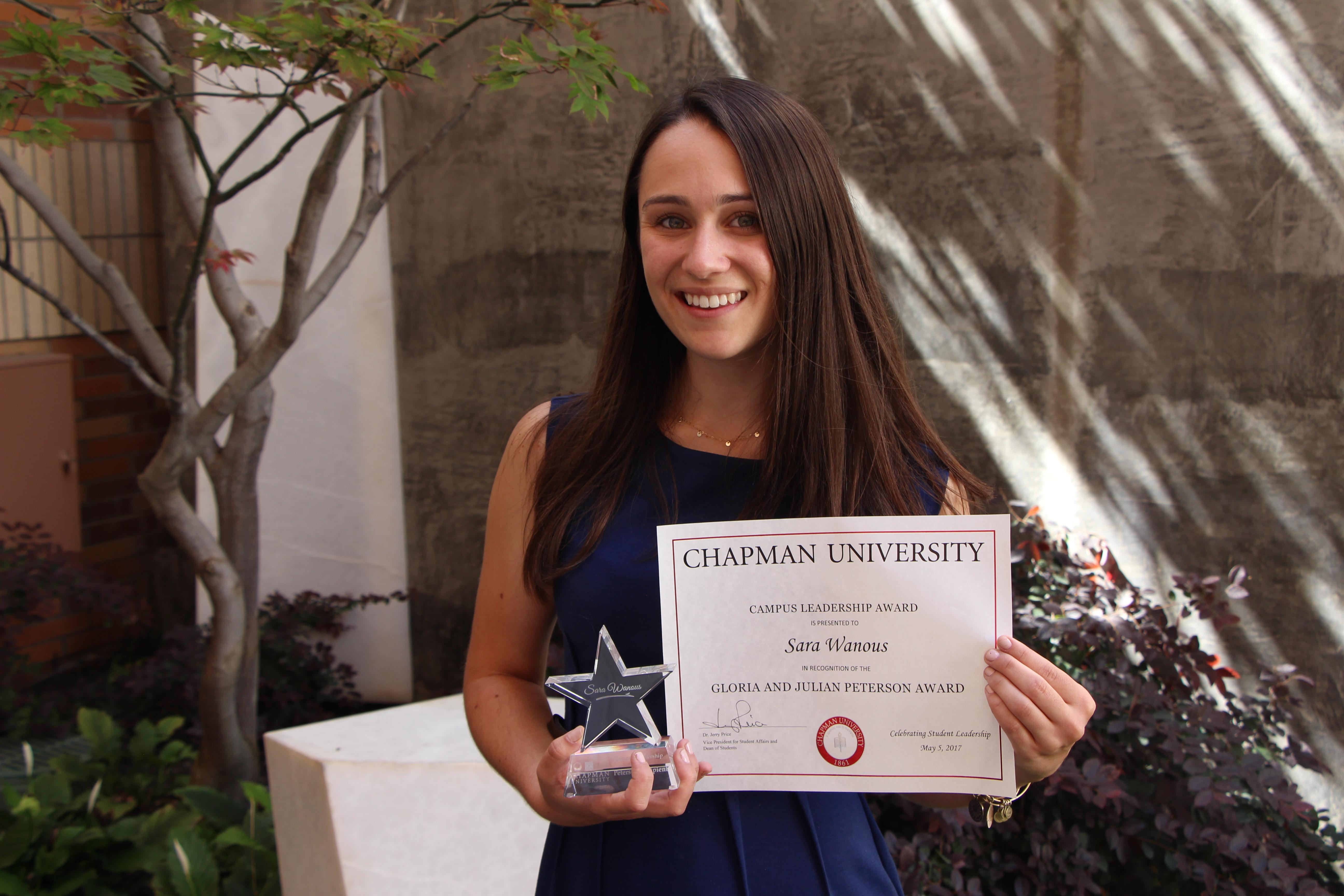 Sara Wanous with award