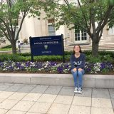 Sara Siwiecki sitting outside Yale's School of Medicine where she's participating in a REU.