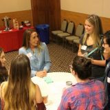 Chapman's Director of PR Sheri Ledbetter talks with GCI students.