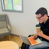 Joshua Goldfaden studying in Keck Center