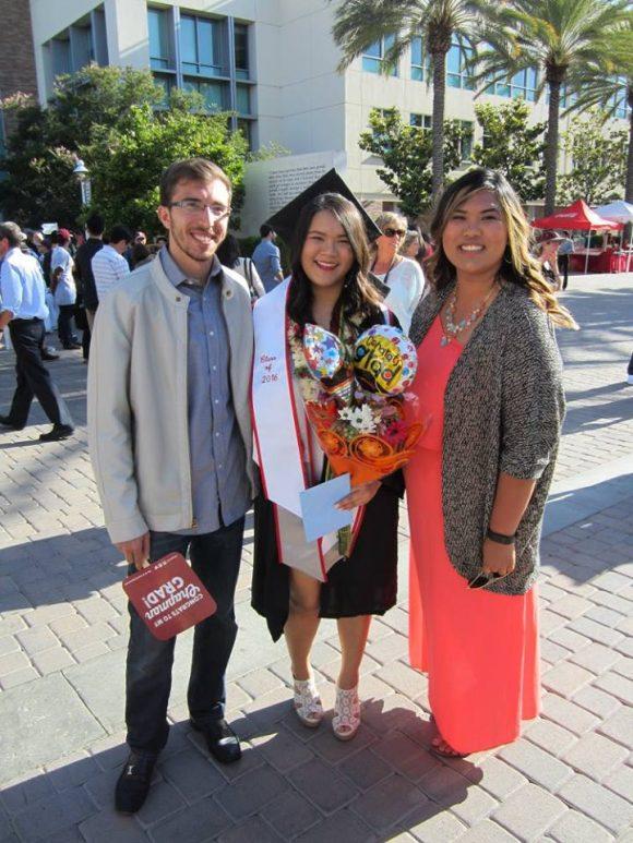 adam kalawi with mentee at their graduation