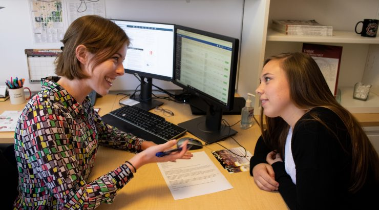 career educator Leanna Izen meeting with a student