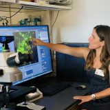 Dr. Patricia Lopes showing her research in Keck lab