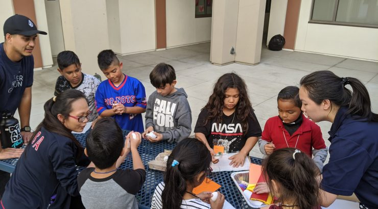 Chapman students working with children at Higher Ground