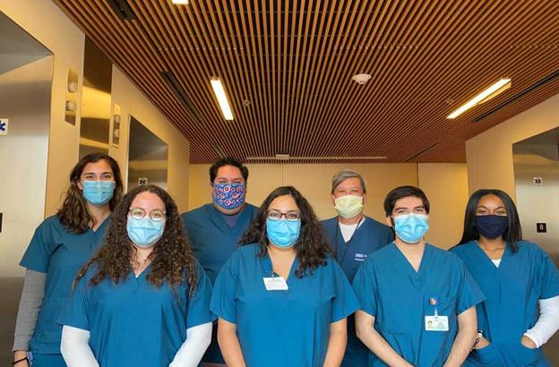 Rosita Saul with her work team