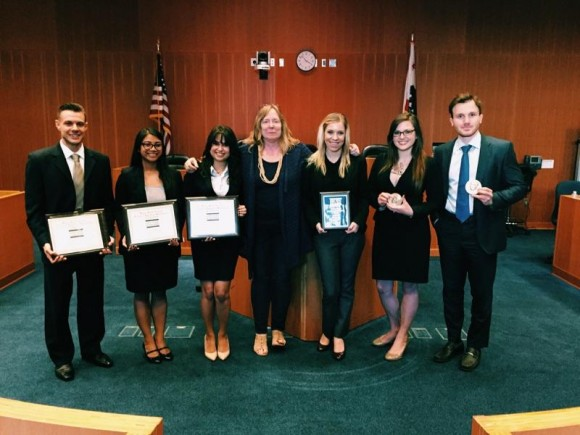 Student holding awards at national moot court