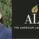 Dean Donal Kochan headshot with Ali logo