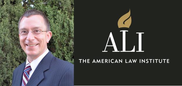 Dean Donal Kochan headshot with Ali logo