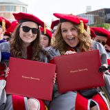 2016 graduates hold up diplomas