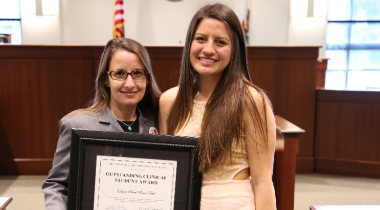 CLEA award winner with professor in courtroom