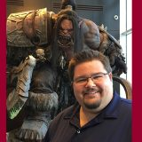 Jack Anderson with a larger than life statue of 'Grommash Hellscream' from World of Warcraft at Blizzard HQ""