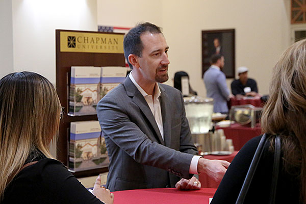Nate Camuti shakes hands with prospective law students