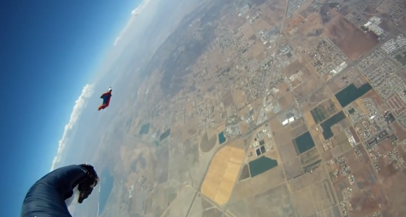 Aerial picture of a skydiver descending to the ground