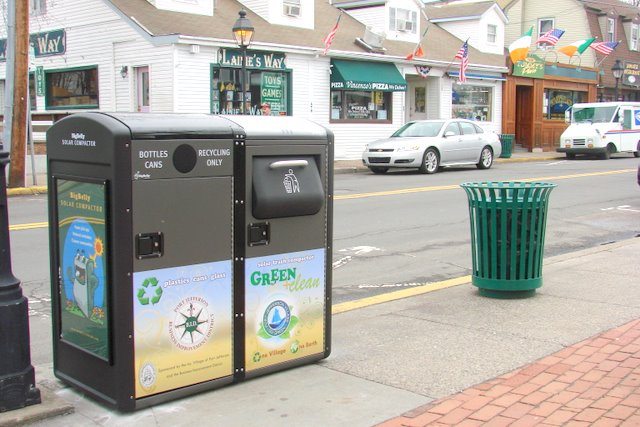 street with recycling receptacles outside.