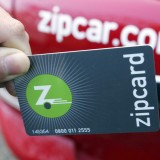 hand holding a plastic card that reads zipcard