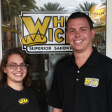 Chiara stands with the owner of Which Wich