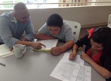 Chapman Ph.D. Candidate Michael Fernandez tutors students at The Wooden Floor.
