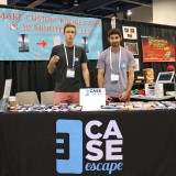 Ryan and his colleague exhibiting at a trade show.