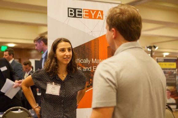 Beeya rep speaking with Chapman student at career fair