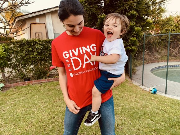 Sarah Buckley in Giving Day shirt with son Finn