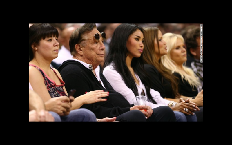 Donald Sterling sitting court-side at a basketball game