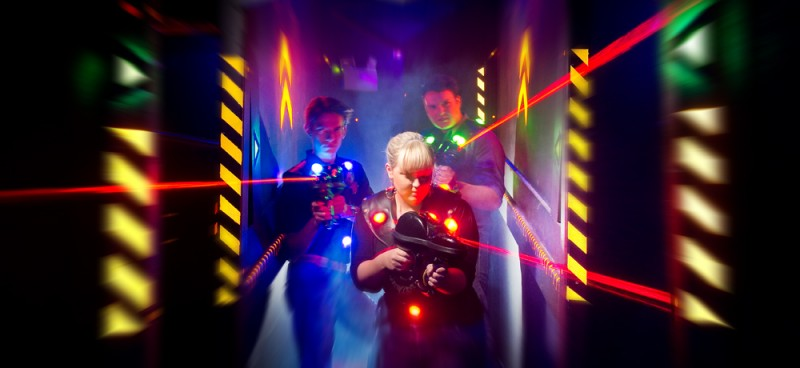 Three people playing laser tag