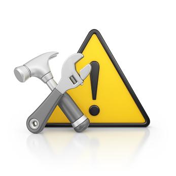 Hazard sign with tools