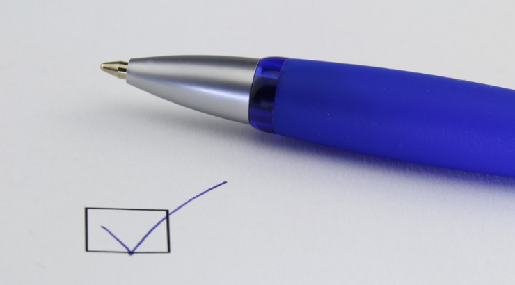 checkmark and blue pen