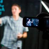 Faculty member in video studio