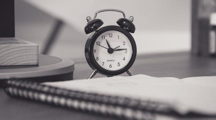 Clock near pad of paper