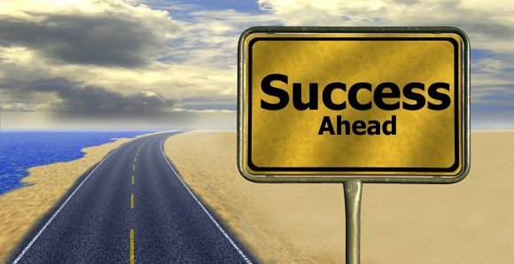 "A road sign that says ""Success Ahead"""