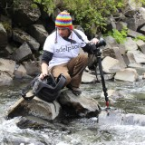 Photog on rock in river