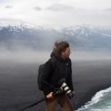 Windblown photog on coast