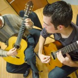 Cogan introduced de Arakal to classical guitar at Chapman, where they now both teach in a program that has developed award-winning ensembles.