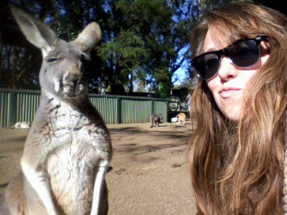 Melanie Kocher '15 with a kangaroo at Featherdale Wildlife Park in Sydney.