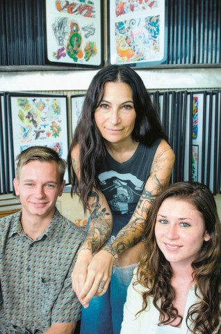 Andrew Heskett '14 and Alyson Vallario '14, right, spent hours interviewing women tattooists, including Jen Davis.