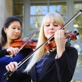 """It is such an honor to be associated with a man whose career so successfully manifested itself in the power of music,"" says Macie Slick '14, right, violinist/violist and one of the first two recipients of a Temianka Scholarship at Chapman. The other, violinist Emily Uematsu '13, is similarly grateful. ""It means so much to me,"" she says, ""and it's going to help many people in the future, as well as allow the conservatory to grow in countless ways."""