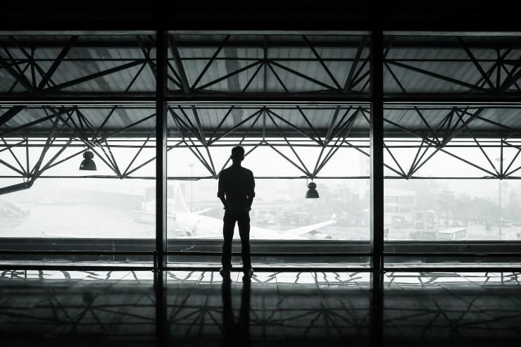 man looking at airplane