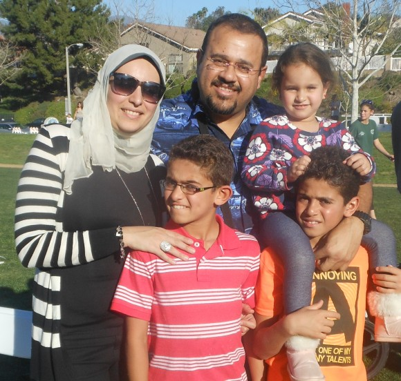 Essraa Nawar pictured with her husband, Hesham El-Askary, Ph.D., professor of earth system science and remote sensing at Chapman, and their three children, clockwise from top right, Hania, Seif and Mohamed.